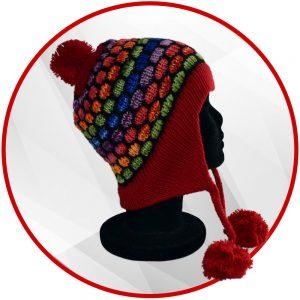 Bonnet péruvien rouge et multicolore avec pompon